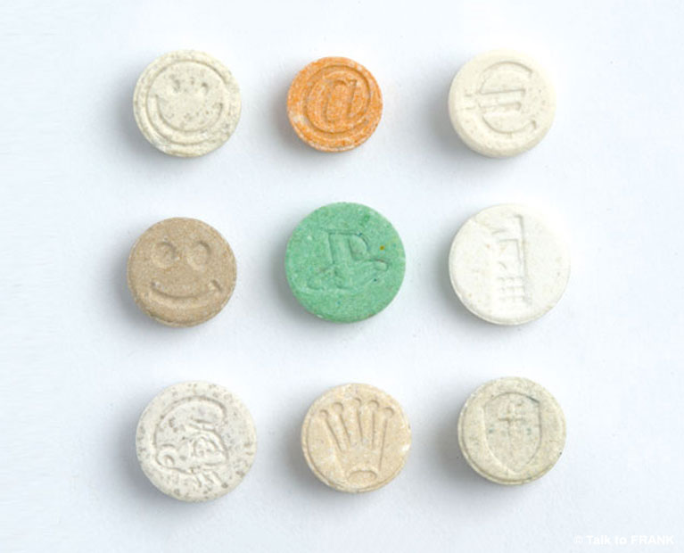 Picture of nine ecstasy tablets arranged in a square